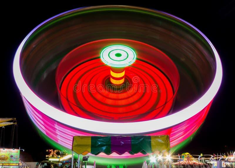 Spinning Ride at Fair. Spinning Ride at a County Fair at Night royalty free stock images