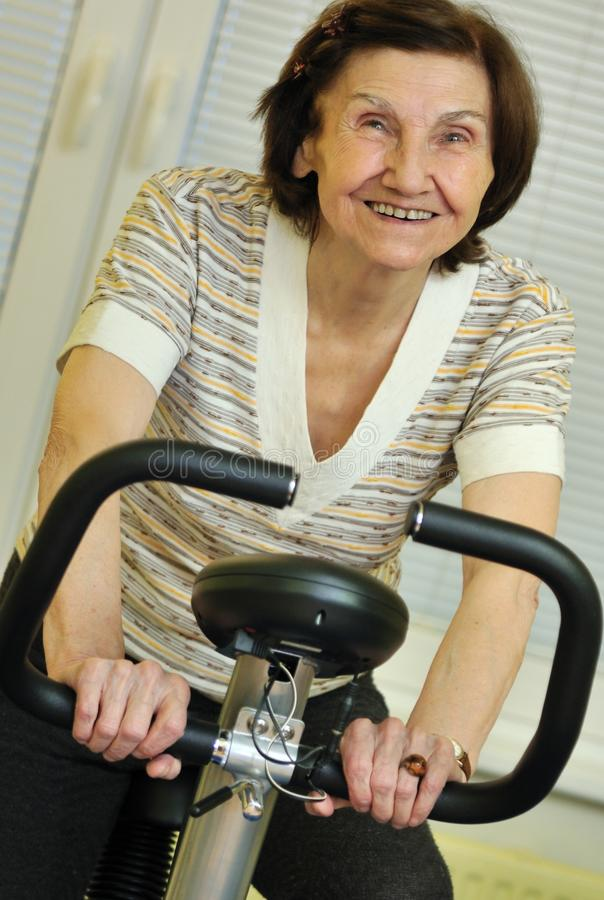 Spinning senior fitness woman stock image