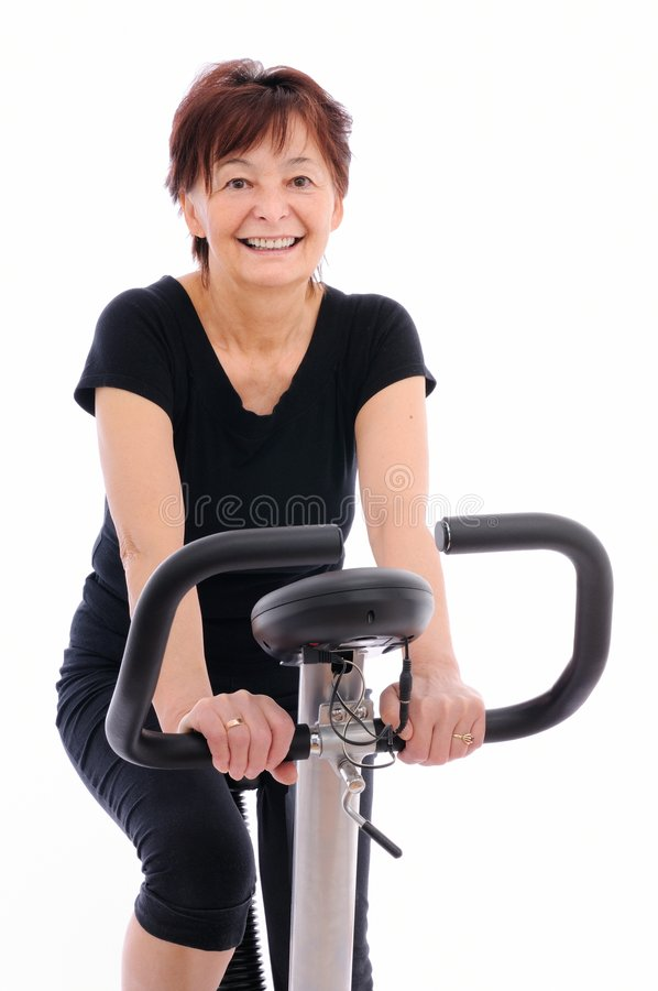 Spinning senior woman royalty free stock photography