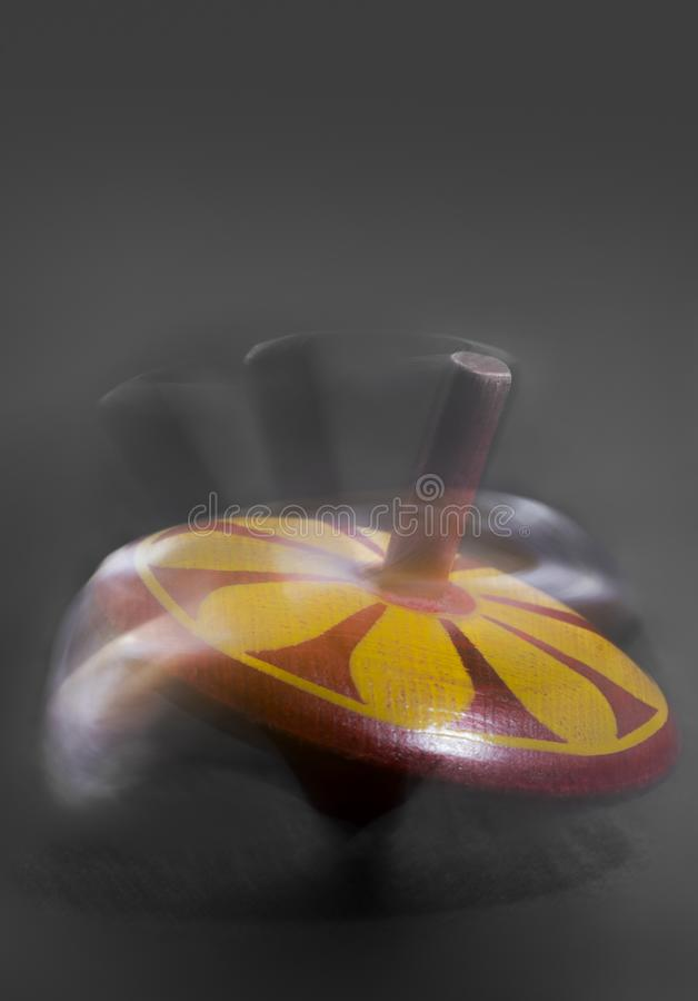 Spinning top in motion stock photography