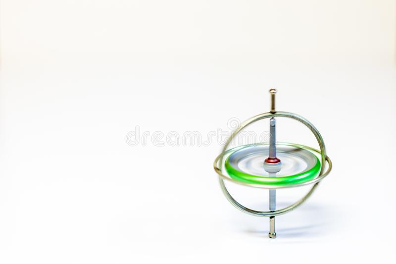 A spinning toy gyroscope isolated on a white background royalty free stock photo