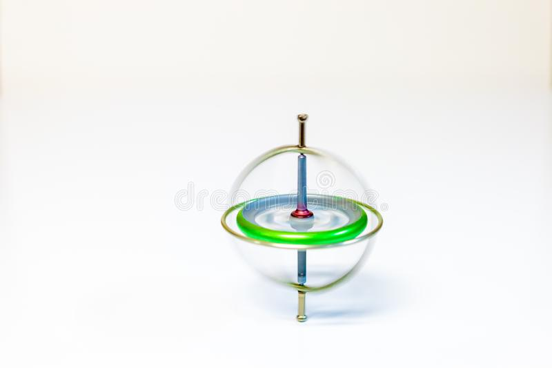 A spinning toy gyroscope isolated on a white background stock images