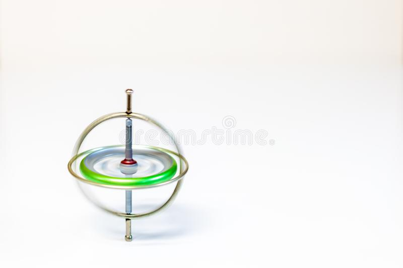 A spinning toy gyroscope isolated on a white background stock photos