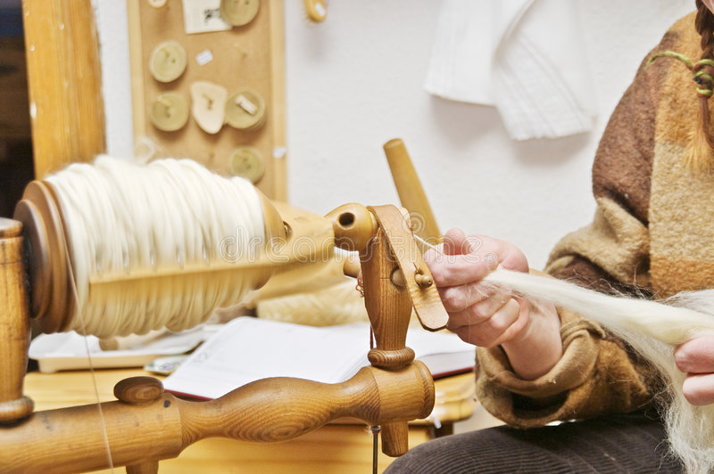 Spinning Yarn from Wool stock image