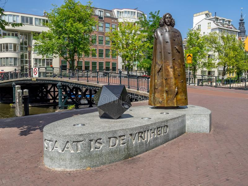 Spinoza monument in the centre of Amsterdam. Amsterdam, Netherlands - July 22, 2018: Spinoza monument in the centre of Amsterdam. There are many monuments around stock photos