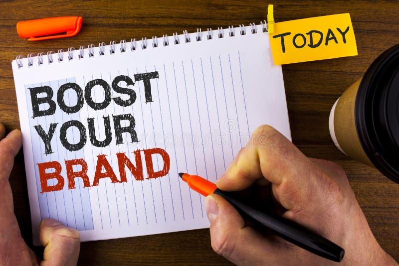 Spinta di rappresentazione del segno del testo la vostra marca La foto concettuale migliora il vostro nome dei modelli nei vostri fotografia stock