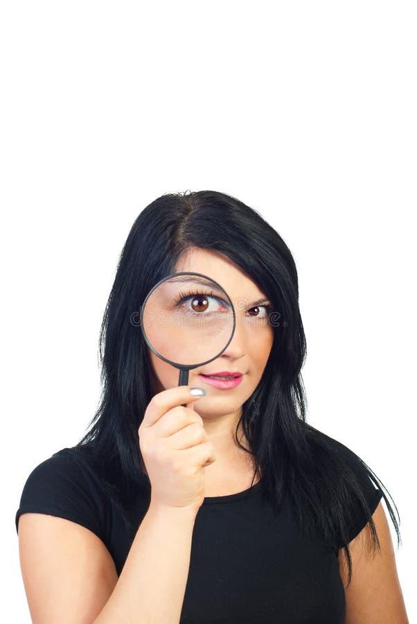Spionerende vrouw stock fotografie