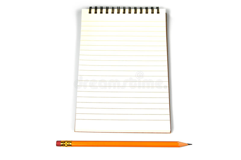 Blank lined paper and a pencil. A spiral bound notebook open at a page of blank lined paper with a wooden pencil lying below royalty free stock images