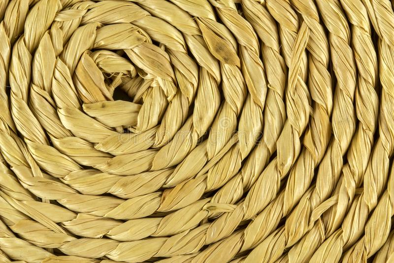 Spiral craftwork with bamboo fibers close up texture royalty free stock images
