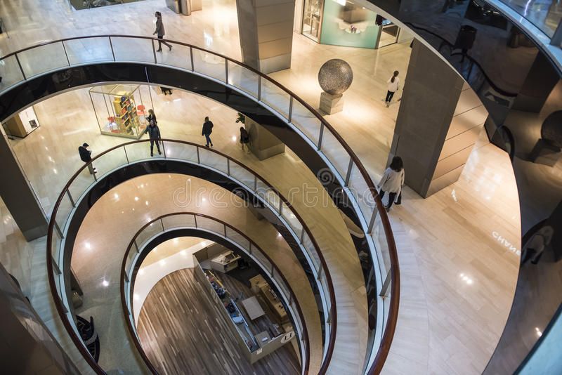 Spiral floor plan in modern shopping centre. stock images