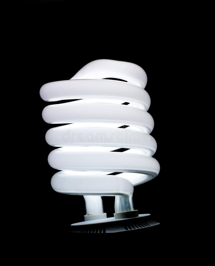 Spiral fluorescent lamp isolated on black. Background royalty free stock photography