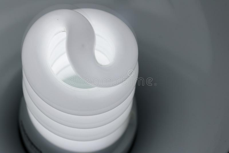 Spiral fluorescent lamp. A fluorescent tube or lamp royalty free stock image