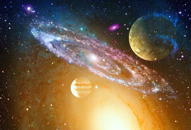 Spiral galaxy and planet in outer space. Elements of this image furnished by NASA royalty free stock image