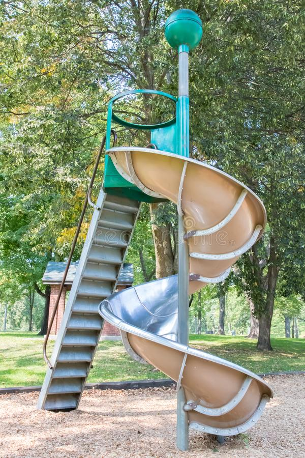 Spiral metal playground slide royalty free stock image