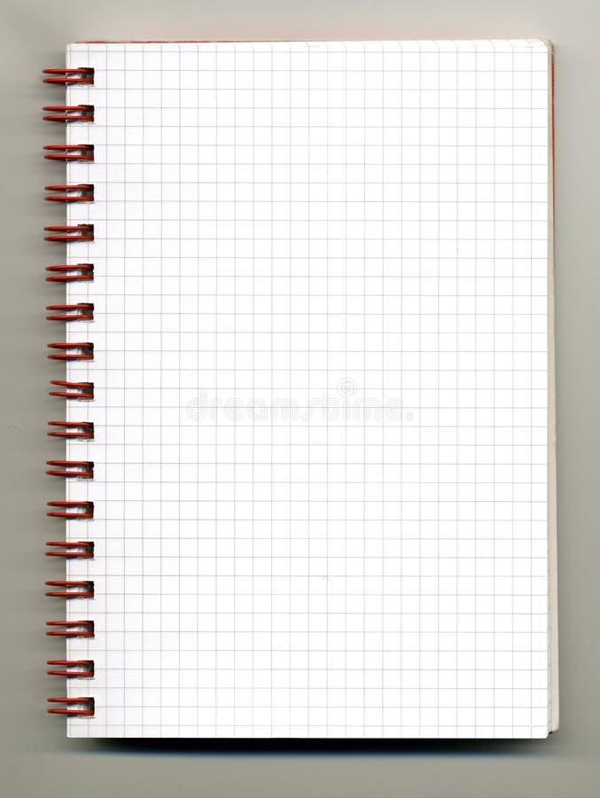 Spiral notebook. Open spiral notebook on gray backround stock photo