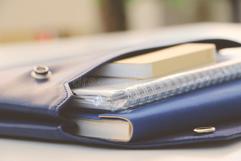 Spiral Notebook on Blue Leather Pouch stock photo