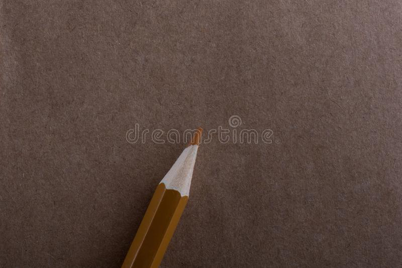 Spiral notebook and a colo pencil. On a white background stock photography