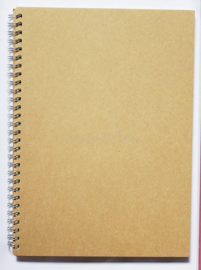 Spiral notebook. Spiral line brown notebook background stock image