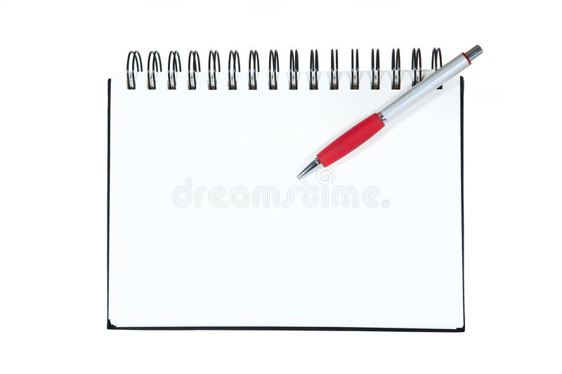Spiral notebook with pen royalty free stock image