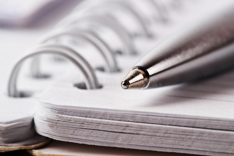 Spiral notebook and pen stock photo