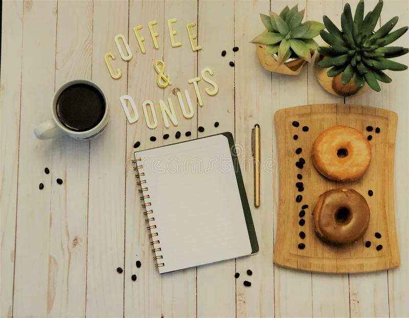 Spiral Notebook Beside Pen and Plants stock images