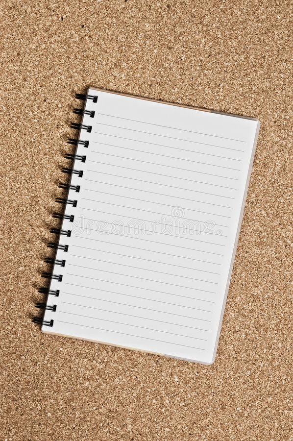 Free Spiral Notepad Over A Cork Surface Stock Image - 5675841