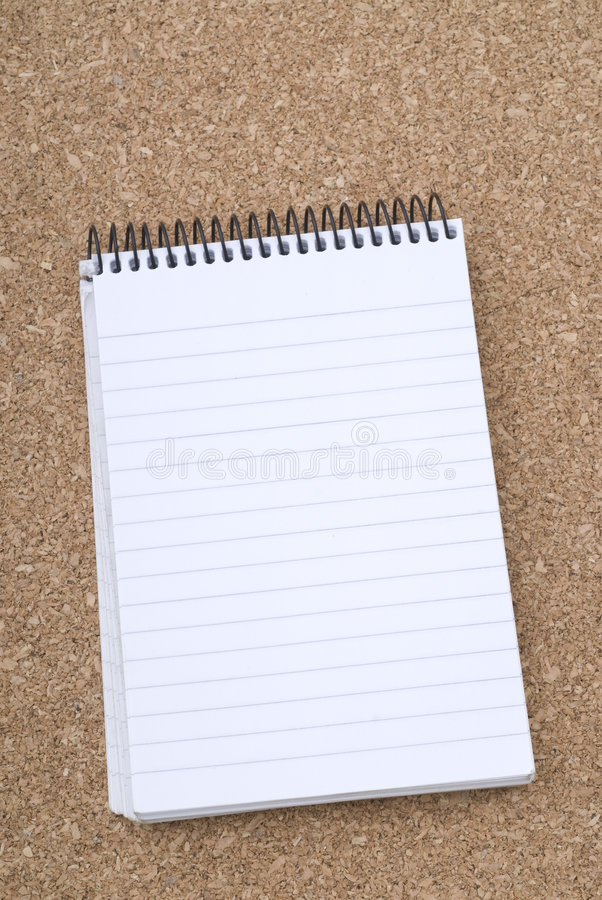 Free Spiral Notepad Over Cork Surface Royalty Free Stock Images - 5499479