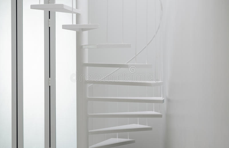 Spiral stair in modern room stock photos