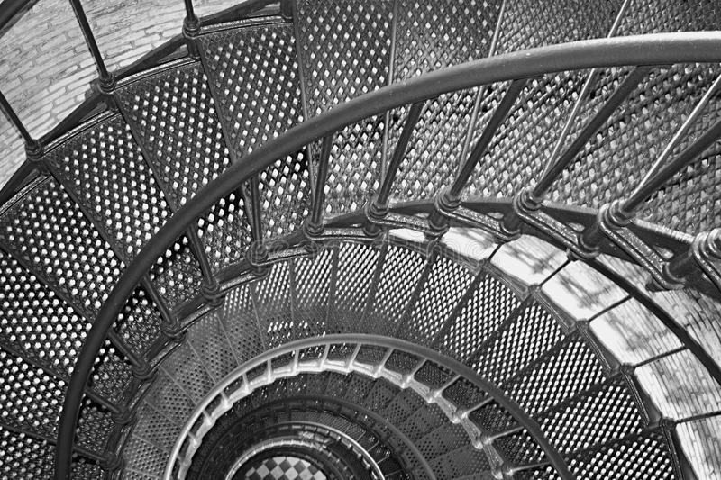 Spiral Staircase. Black and White abstraction of a spiral staircase taken from the top of a brick lighthouse stock photo