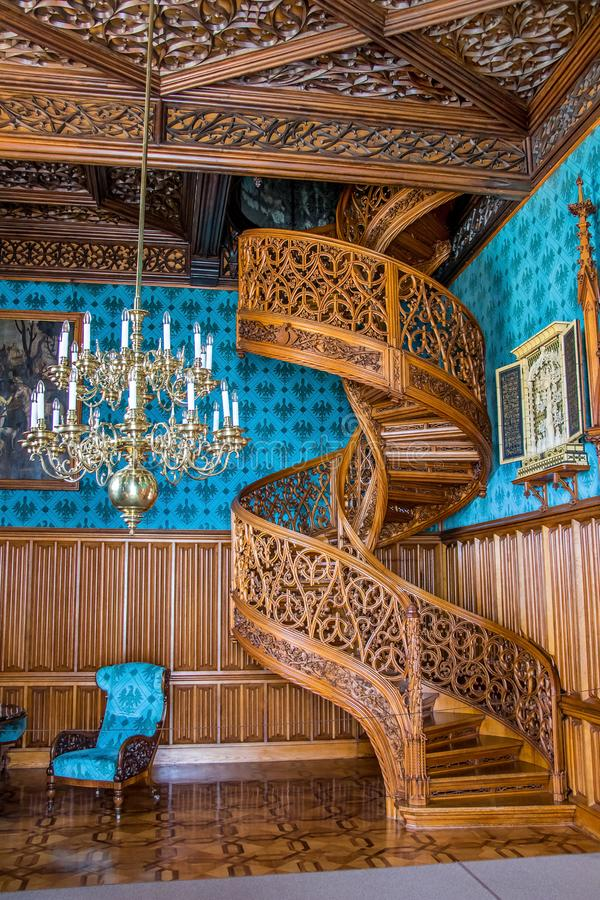 A spiral staircase carved from one a tree, castle Lednice royalty free stock photos
