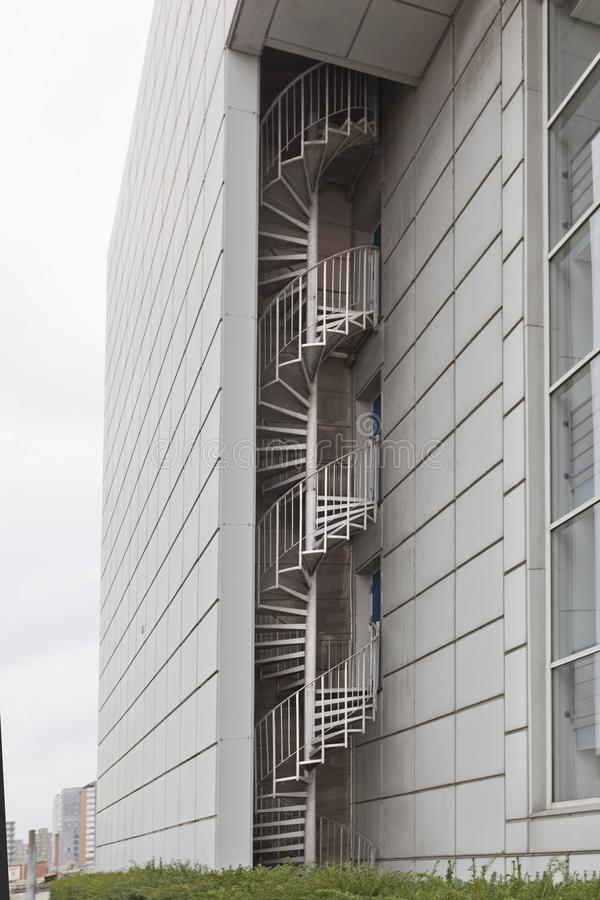 Spiral staircase on the facade of a modern building stock photography