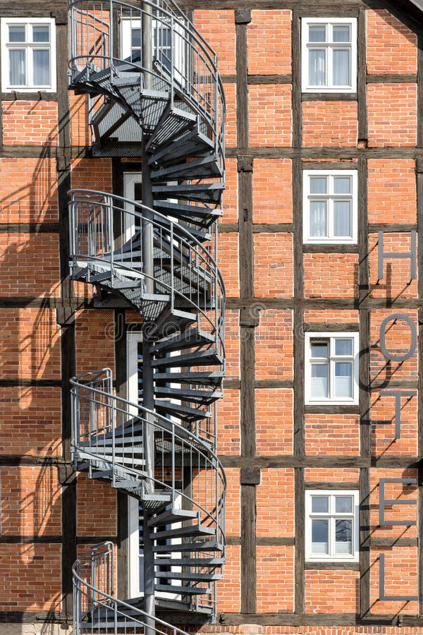 Spiral staircase fire escape on the side of a hotel. Facade royalty free stock photo