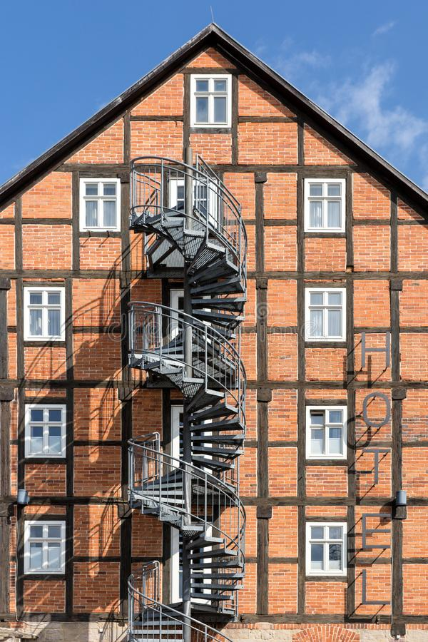 Spiral staircase fire escape on the side of a hotel. Facade stock images