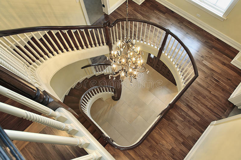 Spiral staircase with foyer view. In new luxury construction home stock photo