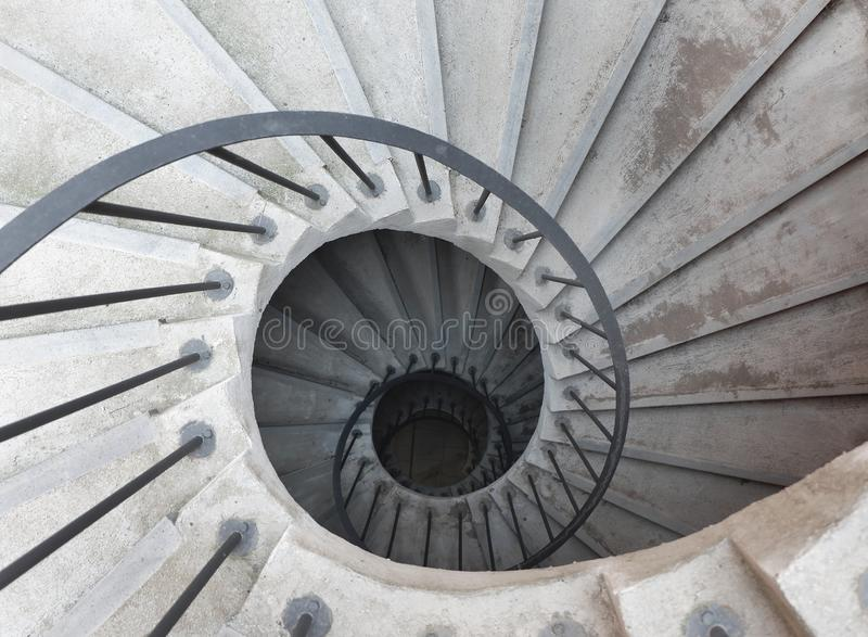 Spiral staircase in the Italian monastery, view from above. Catania, Sicily royalty free stock photos