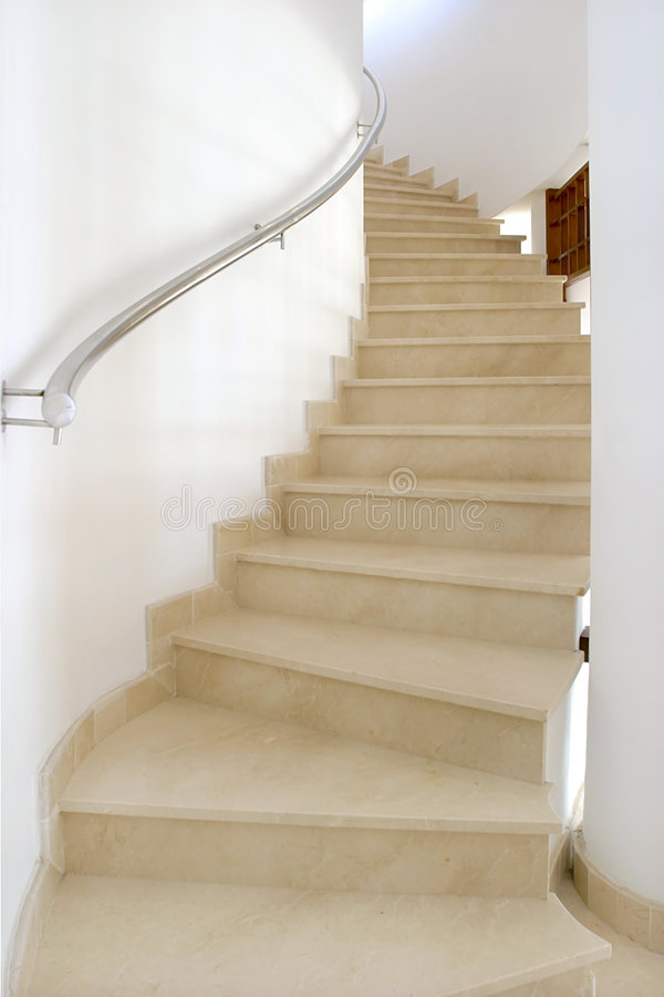 Spiral staircase in large spanish villa leading up to bedroom. stock photos