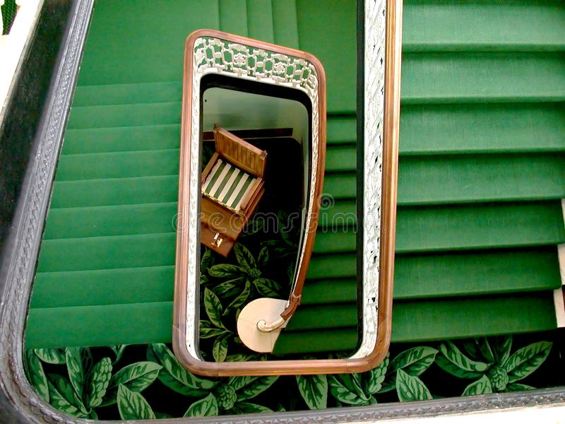 Spiral Green staircase in a rectangular annex stock photography