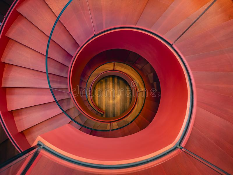 Spiral staircase Modern Architecture detail Red colour Abstract Background. Spiral staircase glass handle Modern Architecture detail Red colour Abstract stock photo