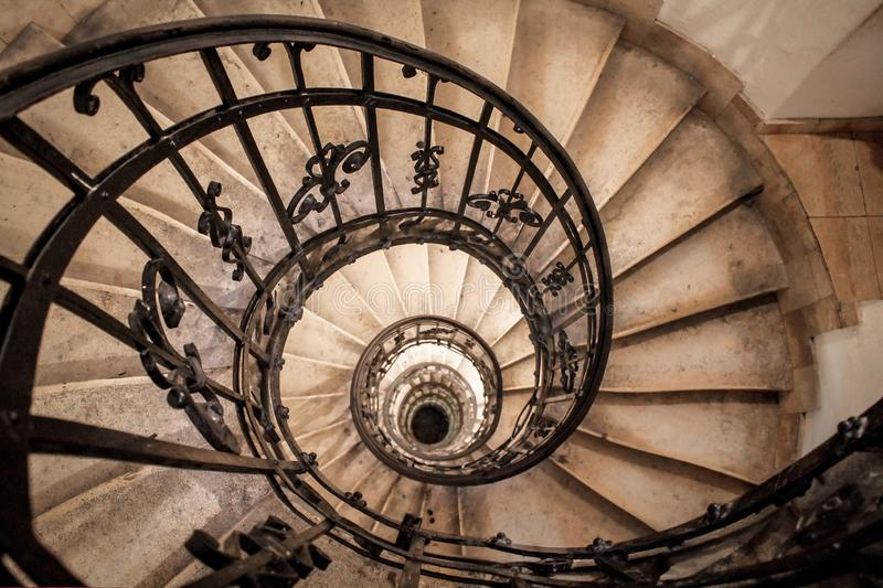 Spiral staircase in an old house close up stock image