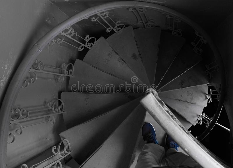 Spiral staircase in the old train close up spirals and descending lines of stairs stock photography