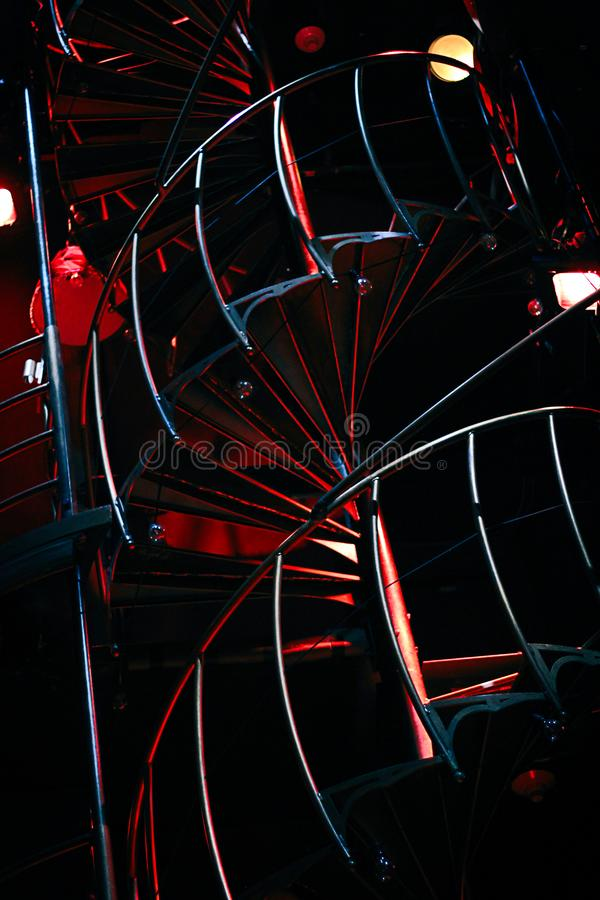 Spiral Staircase with Red Lights stock images