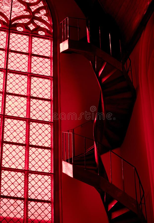 Spiral staircase and window in red church in Amsterdam stock image