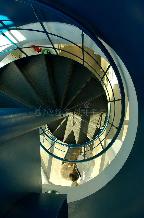 Spiral stairs. Wide-angle view down a spiral stairs from the viewing platform at the highest point of Estonia - Suur Munamägi royalty free stock photos