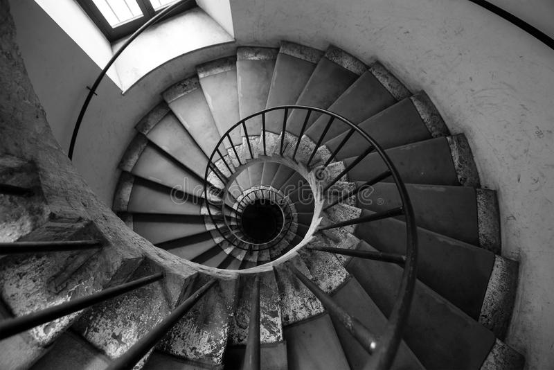 Spiral stairs, black and white. Architecture old Italian palace. Spiral stairs of an old Italian palace. Overhead view of the spiral stairs, ancient historic royalty free stock photography