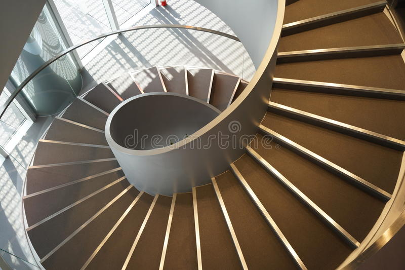 Spiral stairs. Wide-angle view down a spiral stairs from the high point stock photo