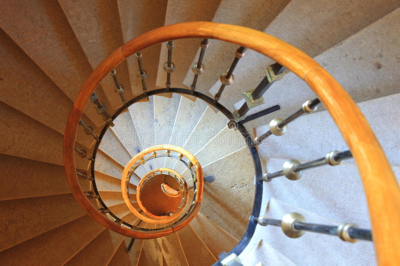 Spiral stairway. In an old building, view from top royalty free stock image