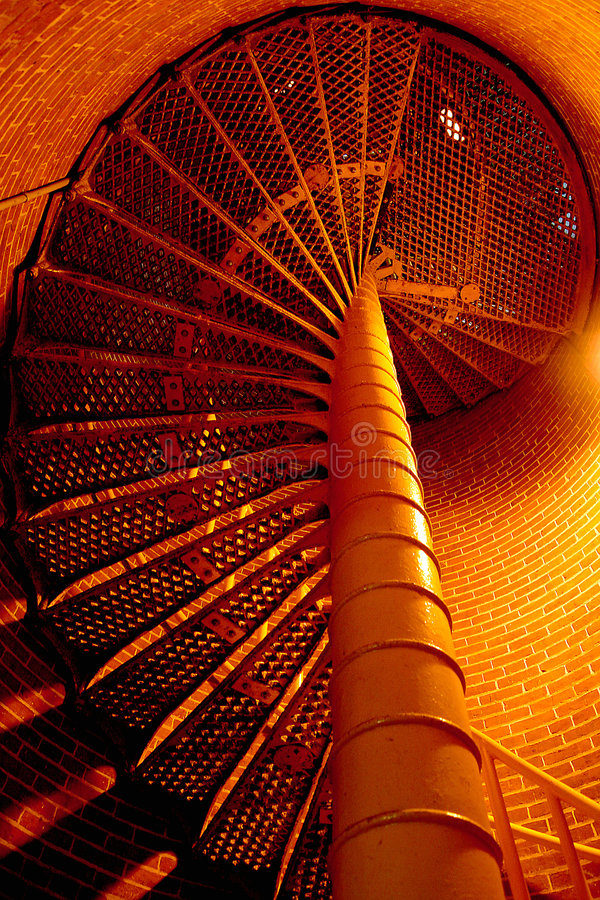 Spiral Stairway. Up the Barnegat Lighthouse, New Jersey, metal stairs and brick walls, spiraling upwards stock images