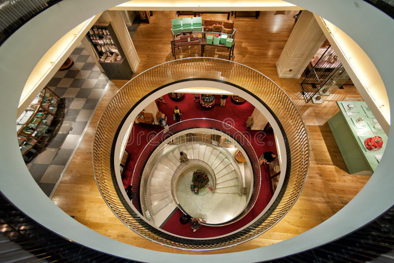 Spiral stairway in Fortnum & Mason. London, UK - June, 2013: Spiral stairway in Fortnum & Mason department store, London, England, UK royalty free stock images
