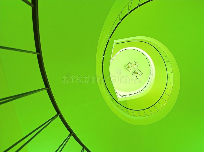 Spiral stairway in green. Spiral stairway in Wilanow palace in Warsaw stock photos