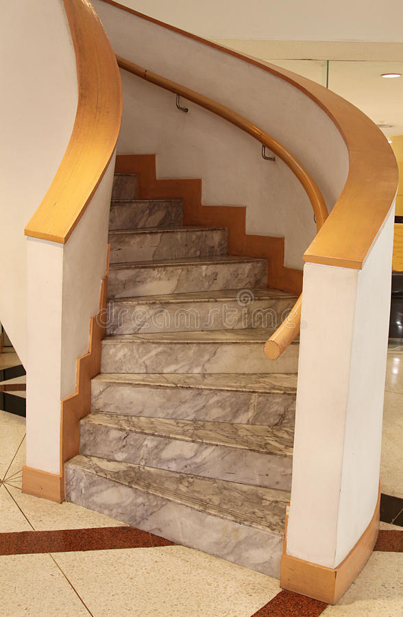 Spiral Stairway. With stone thread, solid balustrade and wooden handrail stock image